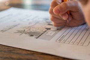 schoolchild solving elementary science test