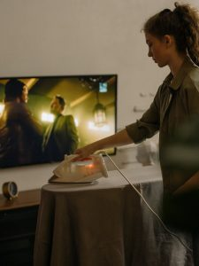 woman in gray button up shirt holding white ceramic plate