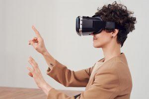 woman using virtual reality goggles